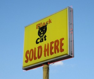 Black cat fireworks sign