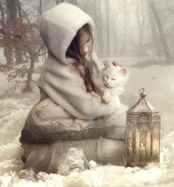 Studio cat photo of young girl and white cat in the snow.