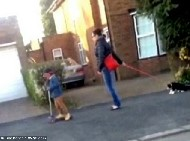 Woman secretly filmed pulling her cat down the street on a lead