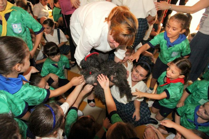 Martha Kane educating 4 - 10 year old children in Malta about cats and dogs