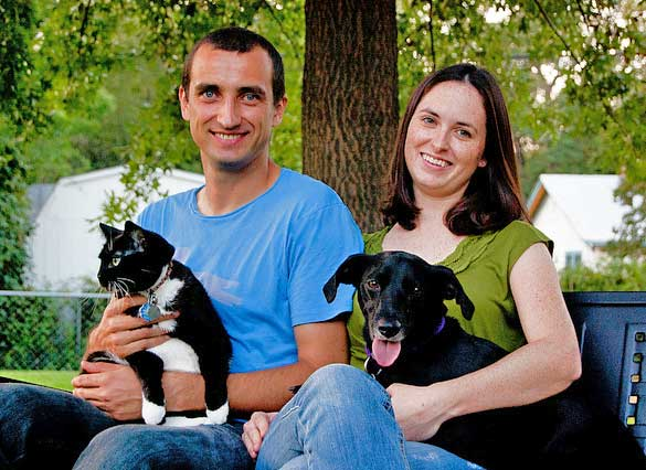 Happy family with dog and cat