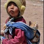 South American child and cat.