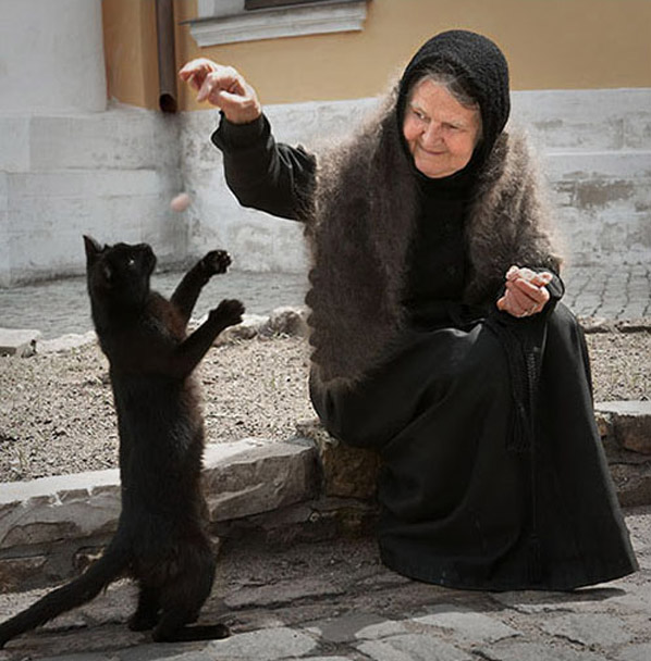 Old Lady in Black with Black Cat