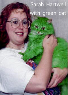 Sarah Hartwell with a green cat