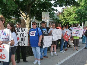 People protesting against cat cruelty