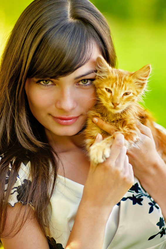 Pretty girl and red tabby kitten