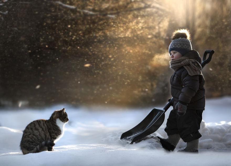 Tabby cat and child