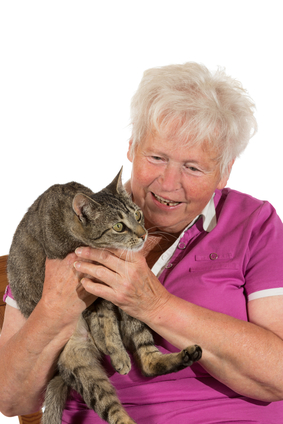 Happy female pensioner with her cat