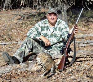 Australian proudly showing off his feral cat kill. It looks ridiculous and sad to me.