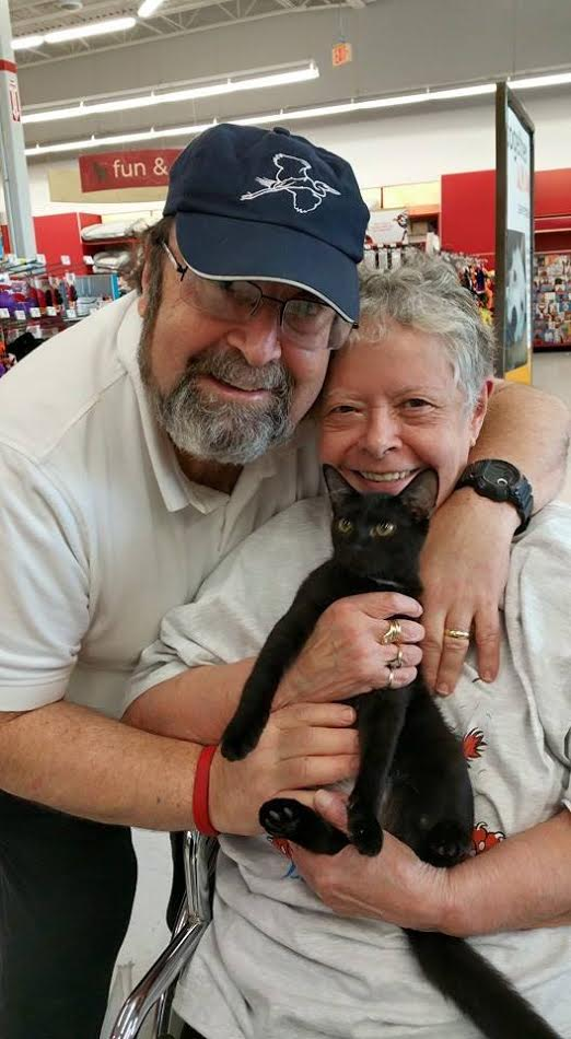 Jo and husband with newly adopted kitten