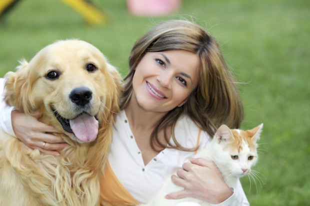 Cat and dog and owner