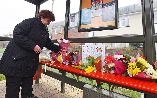 Flowers being placed at the bus stop on Missy's death.
