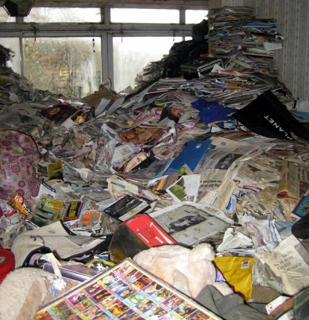 Hoarder accumulated 30 tonnes of rubbish under which 15 rotting cats were found