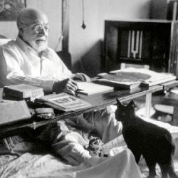 Matisse and his cat kitten. The photograph is copyright Robert Capa of Magnum