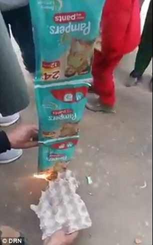 Pampers nappies being burned in the street by hurt Muslims.