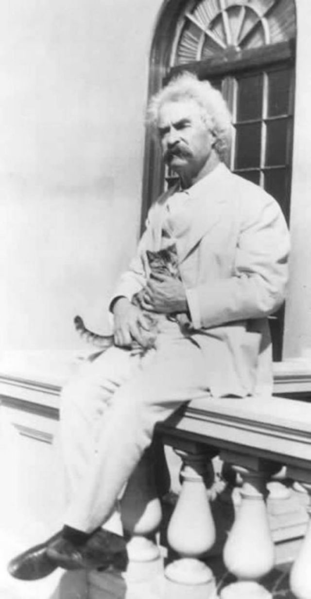 10 photographs of Mark Twain with his cats