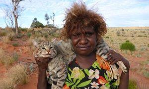 Pintupi hunter and dead feral cat