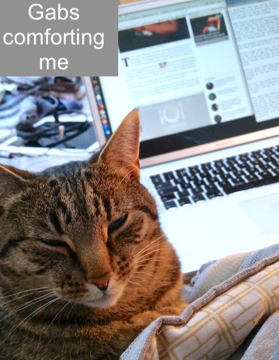 My cat comforting me