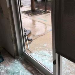 Shattered glass of front door of animal shelter