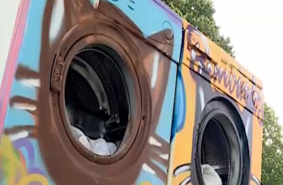 Old washing machines used for cat homes1