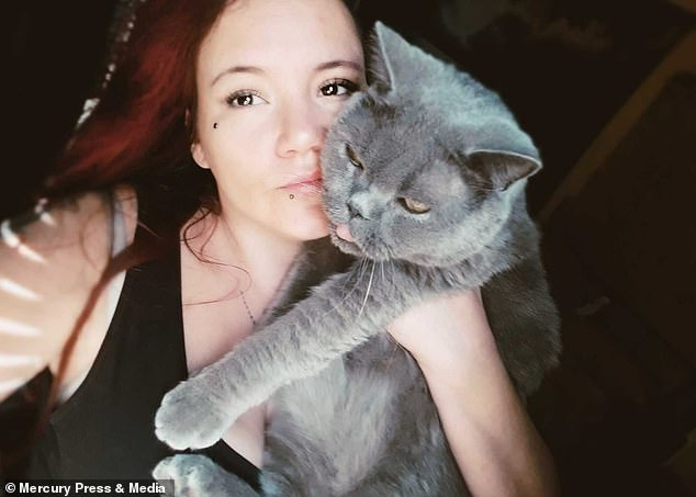 Raven and another of her cats