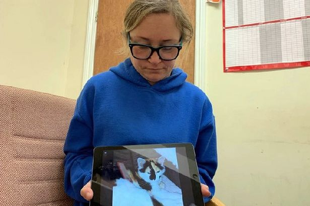 Veronica McMonagle with a picture of her cat