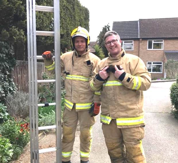 Firefighters Chris Woodland and Ben Buckley with one of the rescued kittens. Photo:  RSPCA SUFFOLK EAST AND IPSWICH.