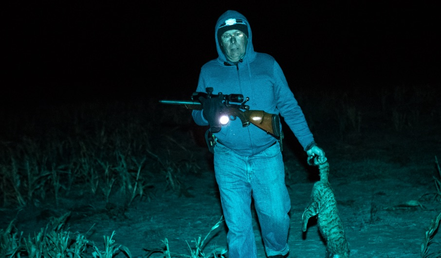Mad bad and sick as far as I am concerned. Man carries tabby feral cat back to where? He's just shot it at night. He's having great fun saving Australia from native species Armageddon at the hands of feral cats. He is a member of the Sporting Shooters' Association of Australia with a cat he shot. Photo: Adam Ferguson for The New York Times