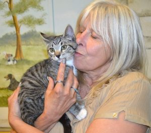 Denise is the person who has adopted Lucky