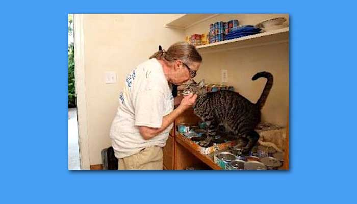 Bradley and one of her cats at her home in Caloosa, West Palm Beach, Florida, USA.