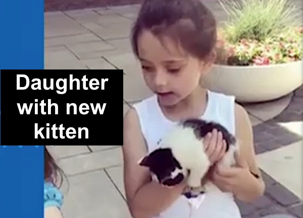 Justin Moore's daughter with newly adopted kitten