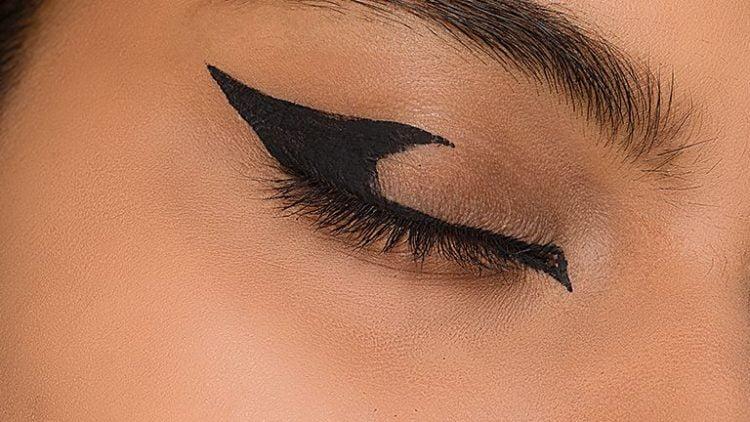 Feline eye makeup on woman.