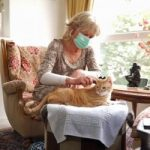 Christiane Panis is so allergic to cats that she usually wears a mask when she combs her cat's fur.