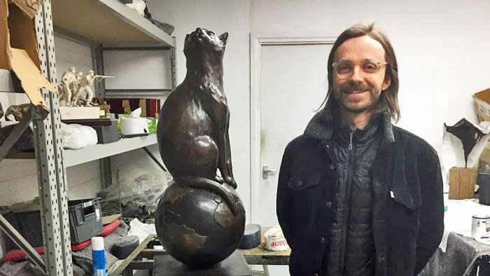 Matthew Serge Guy with his cat statue
