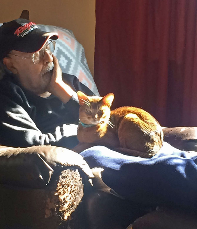 Picture of 90-year-old man with cat before coronavirus got him
