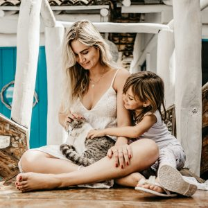 Child and mother with cat