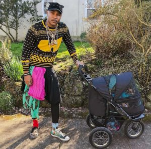 The Cat Rapper with a cat stroller