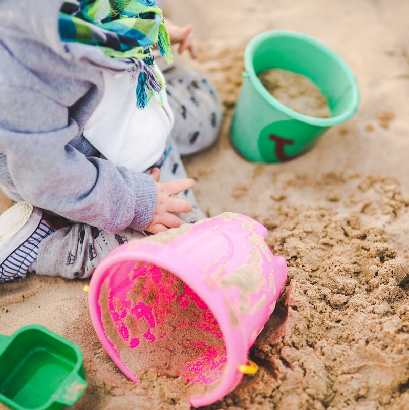 Child playing in sand