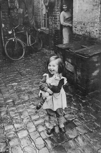 Young French girl showing off her cat 1959