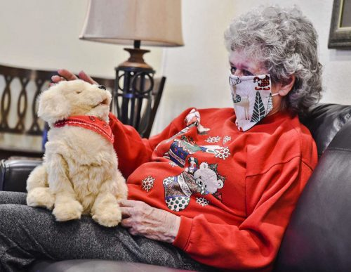 Muffie the robotic dog and Margie her owner