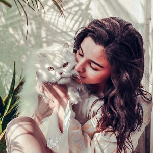 Alia Butt and her white Persian cat
