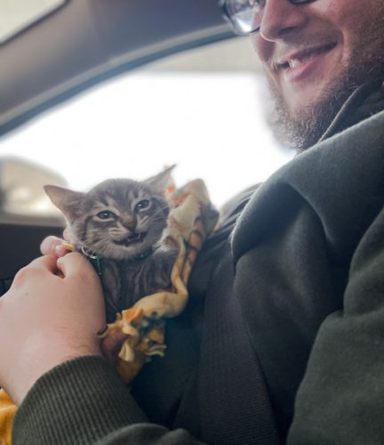 Guy has just picked up his rescue kitten called Frog and his girlfriend who took the photo can't tell who is happier