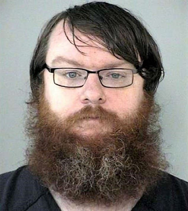 Graham Williiam Reid aged 29 a high school teacher who tortured and killed his 4 young cats
