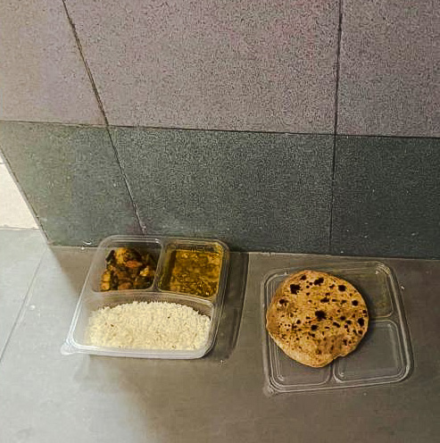 Someone put out a vegetarian spicy meal for humans for community cats to eat in an HBD condominium in Singapore