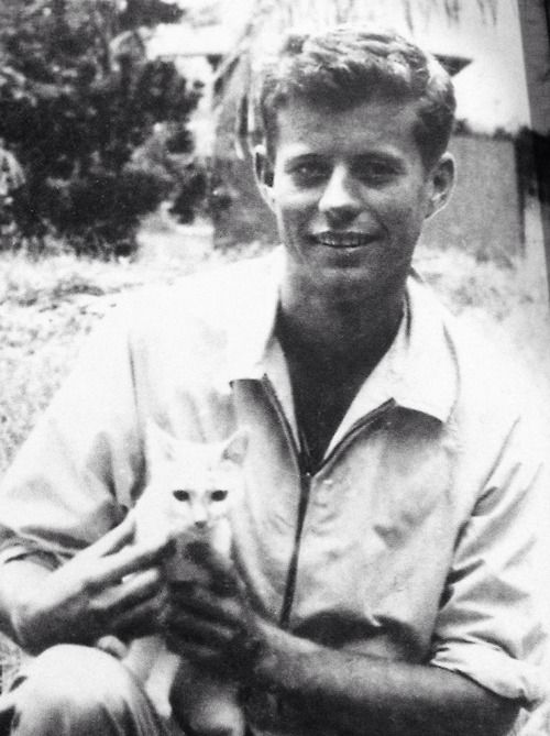 Early picture of John Kennedy holding a kitten when visiting the Solomon Islands in 1943