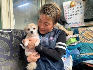 Kim Gea-yeung, manager of an animal shelter for abandoned dogs and cats, holds Jin-hui, a five-year-old Pomeranian dog, who was rescued from under the ground, in Anseong, South Korea,