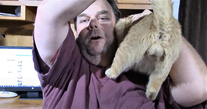 Man shows off his cat's balls