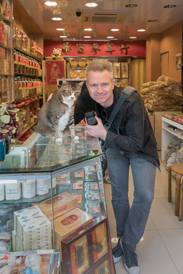 Marcel Heijnen and one of China's shop cats