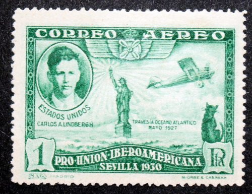 The first stamp to feature a cat issued in 1930 by Spain to commemorate the first non-stop transatlantic flight by Charles Lindberg