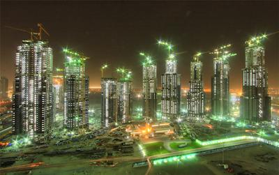 Dubai construction - Rapid expansion in Dubai resulted in too much debt and a fagile economy - photo by twocentsworth (Flickr)